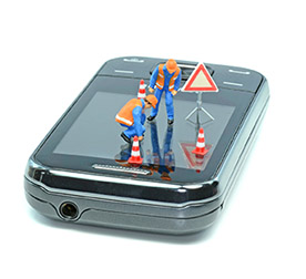 Roadworkers working on top of a phone